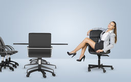 Busineswoman sitting on chair relaxing and looking Royalty Free Stock Photography