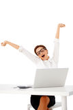 Busineswoman stretching and yawning Stock Photo