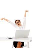 Busineswoman stretching and yawning Stock Photo