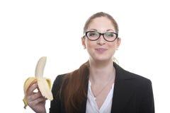 Businnes dama z obranym bananem Obrazy Royalty Free
