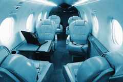 Businnes turboprop aircraft interior - seats with lowered armres Stock Photo