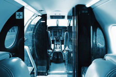 Businnes turboprop aircraft interior - seats with lowered armres Royalty Free Stock Image