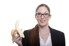 Businnesdame met banaan Stock Afbeeldingen