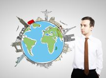 Businnesman drawing colorized earth Royalty Free Stock Photo
