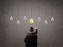 Businness guy in front of idea light bulbs concept Stock Photography