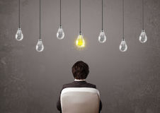 Businness guy in front of idea light bulbs concept Stock Image
