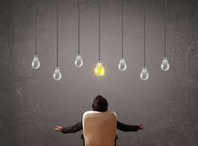 Businness guy in front of idea light bulbs concept Royalty Free Stock Photography