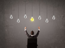 Businness guy in front of idea light bulbs concept. Businness guy in front of bright idea light bulbs concept Stock Photo