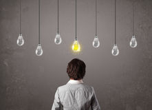 Businness guy in front of idea light bulbs concept Royalty Free Stock Images