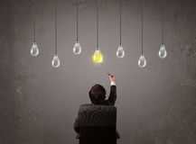 Businness guy in front of idea light bulbs concept Royalty Free Stock Image