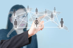 Busiusiness woman pushing people social network. Stock Photo
