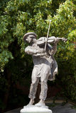 Busker. Monument of fiddler in Torun. Home town of Copernicus Royalty Free Stock Photos