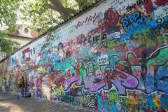 Busker and art at the Lennon Wall in Prague Stock Photography