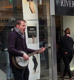 Busker With Banjo In Galway Ireland. Busker entertaining shoppers in Galway Ireland stock photos