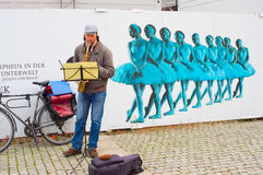 Busker, Berlin. BERLIN, GERMANY - NOVEMBER 15, 2014: Unedentified musician playing music on the Berlin street Stock Images