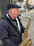 Busker do saxofone Fotografia de Stock