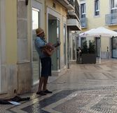 Busker With Guitar In Faro Portugal arkivfoton