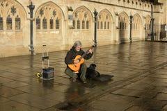 Busker guitarist outside Bath Abbey. England Royalty Free Stock Photography