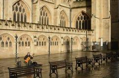 Busker guitarist outside Bath Abbey. England Stock Photos