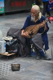 Busker. I meeted this charming busker,when I traveled in Huaibei Royalty Free Stock Photo