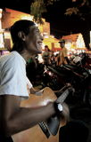 Busker young man Jogyakarta Indonesia Royalty Free Stock Photography