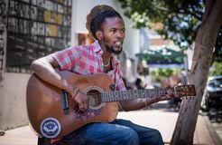 Busker on Johannesburg streets in daylight. royalty free stock photos