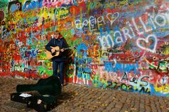 Busker by the John Lennon Wall in Prague Royalty Free Stock Images