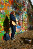 Busker by the Lennon Wall in Prague Royalty Free Stock Photography