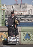 Busker musician on Westminster Bridge, London, UK Royalty Free Stock Photo