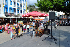 Busker in the old town of Albufeira, Portugal Royalty Free Stock Images
