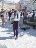 Busker in Old Town Square in Prague. Old Town Square is a historic square in the Old Town quarter of Prague, the capital of the Czech Republic. It is located Royalty Free Stock Photos
