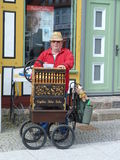 Busker playing barrel organ Stock Photo
