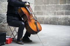 Busker playing the cello stock photo