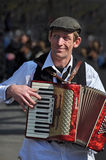 Busker Playing Piano Accordion in New York. Spring - 09 April 2008, Greenwich Village, New York. A Busker plays a beautiful red Weltmeist Piano Accordion in the stock photos
