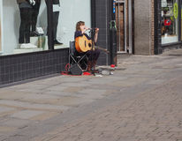 Busker playing in Salisbury Stock Photography