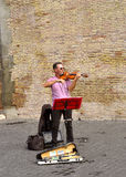 Busker playing the violin Royalty Free Stock Photography