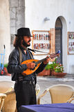 SORRENTO, ITALY - AUGUST, 8: Busker at the restaurant in Sorrento, August 8, 2013 Royalty Free Stock Image