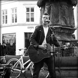 Busker sing and playing guitar. Copenhagen, denmark - november 08, 2014 Street musician sing and plays guitar on strøget, copenhagen. Dozens buskers perform on Royalty Free Stock Photo