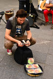 The  busker (street musician) with money Royalty Free Stock Image