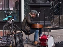 Busker / Street Musician singing and playing guitar on Grafton Street in Dublin stock image