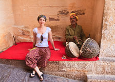 Busker and tourist. India Royalty Free Stock Photos