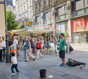 Busker in  Vienna. VIENNA, AUSTRIA - JULY 31, 2015: people walking and busker show  in old town center of Vienna on  july 31, 2015 in Vienna Stock Images