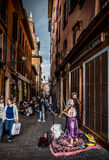 Busker violinist. Bologna, Italy, 18 September 2016: two buskers violinists perform for the passersby in the historic district of Bologna before the storm Stock Image