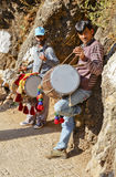 Buskers busking Shiva Kodi Himalayas Stock Photo