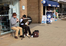 Buskers. Cromer, Norfolk, UK. September 22, 2016. Two buskers entertain shoppers on the main street at Cromer in Norfolk royalty free stock photos