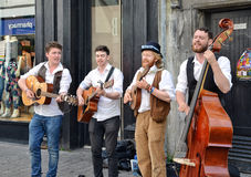 Buskers in Galway. GALWAY, IRELAND - MAY 2016: Buskers performing music on the streets of Galway royalty free stock photography