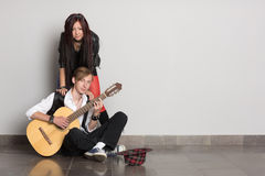 Buskers  at a gray wall Royalty Free Stock Image