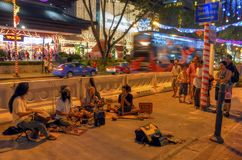 Buskers at Orchard Road. Buskers entertaining pedestrians along the famous Orchard Road in Singapore Stock Images