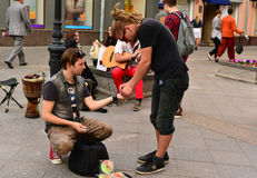 The  buskers (street musicians) share earnings Stock Photo