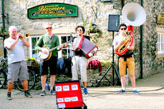 Busking at Bakewell, Derbyshire. BAKEWELL, DERBYSHIRE, UK. APRIL 08, 2015. A group busking on the street at Bakewell in Derbyshire, UK royalty free stock photo